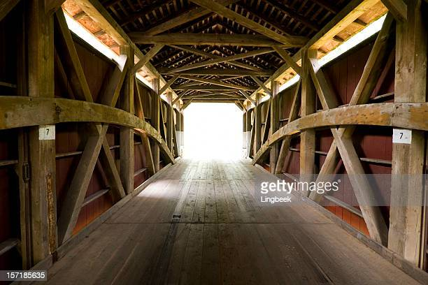covered bridge in amish county towards the light - covered bridge stock photos and pictures