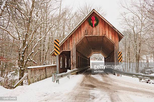 covered bridge in winter - covered bridge stock photos and pictures