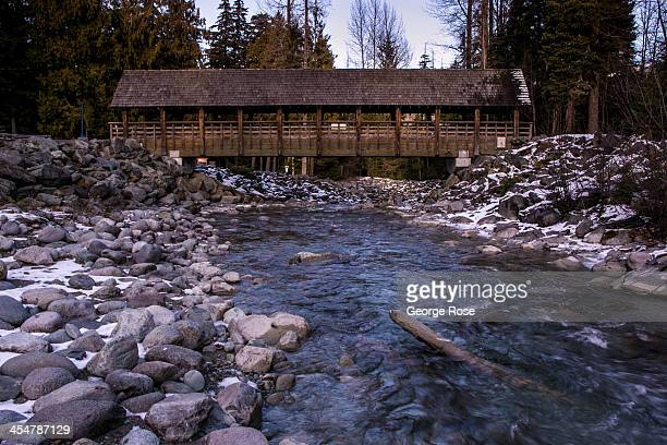 A covered bridge is part of an elaborate creek trail system throughout the Village on November 27 2013 in Whistler British Columbia Canada The world...
