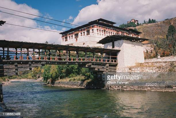 Covered bridge over Paro River leading to the Rinpung Dzong monastery and former fortress Paro Bhutan 2004
