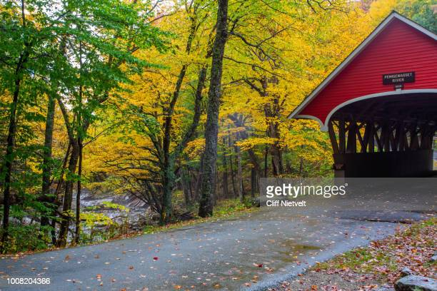 1886 covered bridge over pemigewasset river - new hampshire stock pictures, royalty-free photos & images