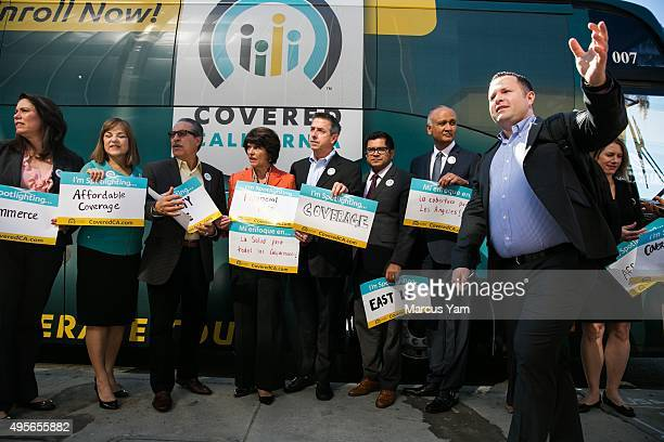 LOS ANGELES CALIF SUNDAY NOVEMBER 1 2015 Covered California executive director Peter V Lee center gather with local lawmakers as they get ready for a...