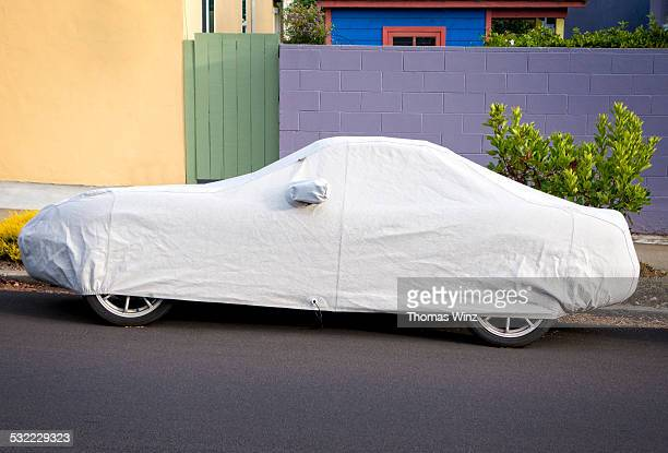 Covered Car parked on street