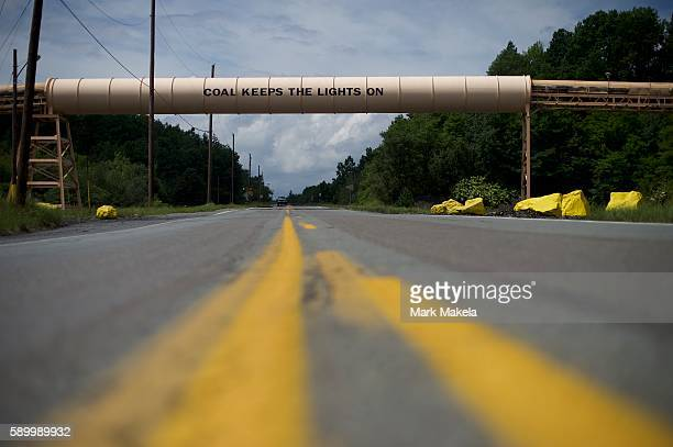 A covered coal mining conveyor belt states 'Coal Keeps The Lights On' across a road on August 14 2016 in Manahoy City Pennsylvania The small...
