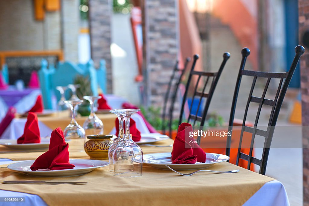 Covered dining table in restaurant : Stock Photo