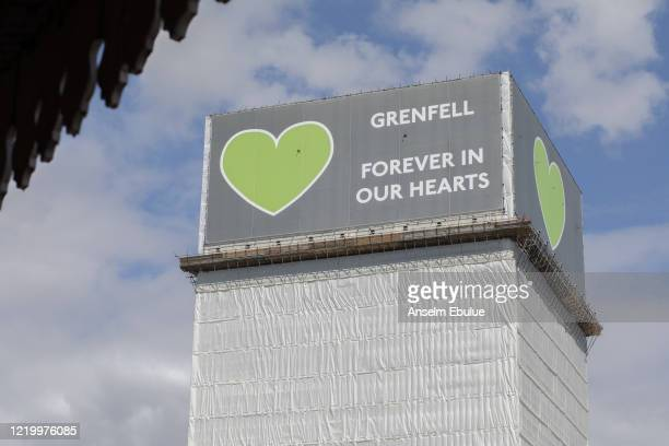 A covered Grenfell tower stands on June 14 2020 in London England Official memorials for the 2017 Grenfell Tower fire which killed 72 people were...