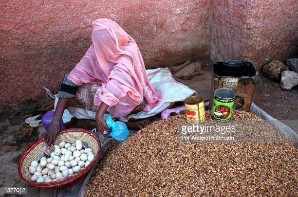 A covered muslim woman sells eggs at a market February 11 2001 in the old city in Harar in eastern Ethiopia In this primarily Muslim area a campaign...