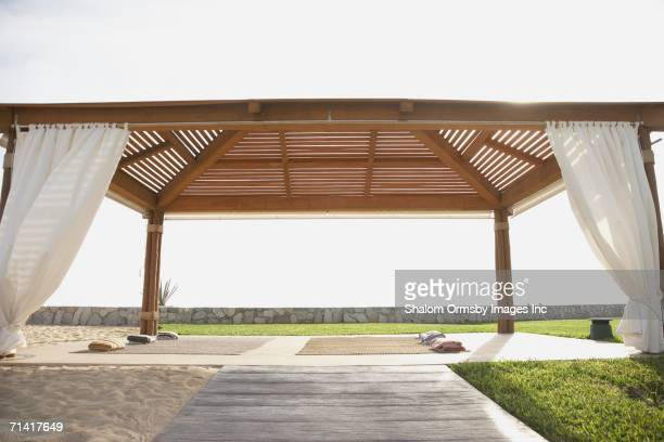 covered outdoor yoga area - gazebo stock pictures, royalty-free photos & images