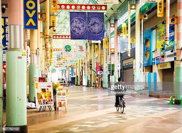 Covered street market in Ustunomiya Tochigi prefecture with cyclist