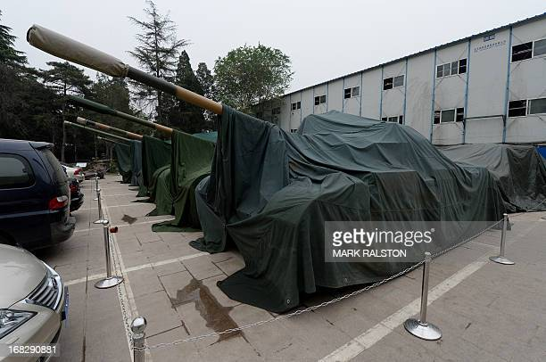 Covered tanks at the Chinese Military Museum in Beijing on May 8 2013 Beijing dismissed an annual Pentagon report that accused it of widespread...