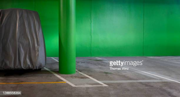 covered van in a parking garage - tarpaulin stock pictures, royalty-free photos & images