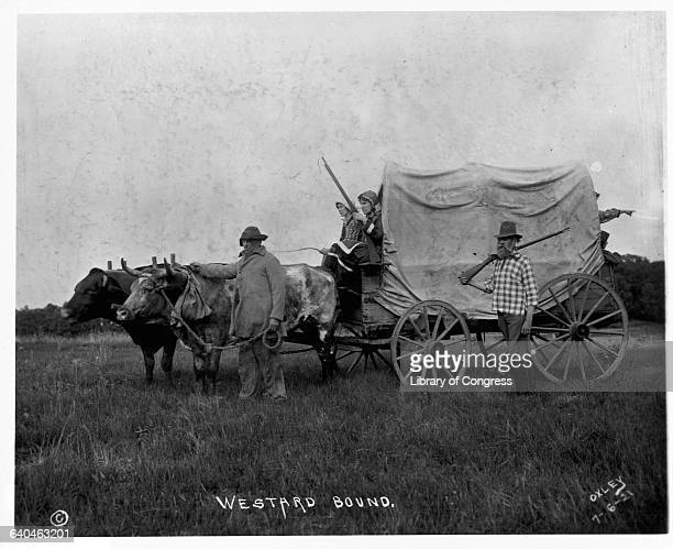 Covered Wagon and Pioneers Heading to American West