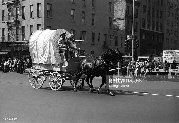 Covered Wagon on street during parade