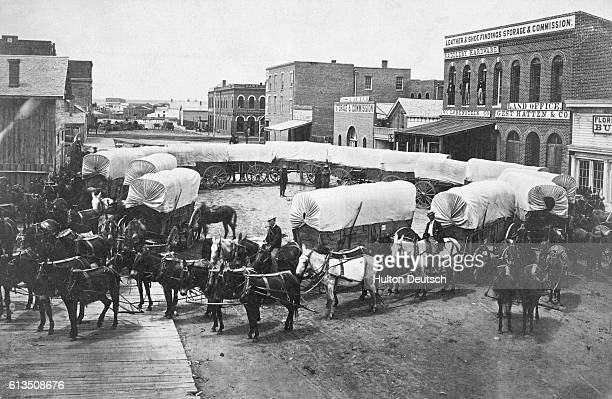 Covered wagons about 1863 concentrating in Denver Colorado