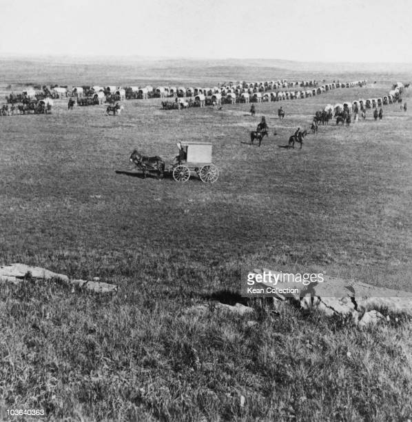 Covered wagons and riders on horseback gather during Custer's Black Hills Expedition USA circa 1874 The expedition led by thenLieutenant Colonel...