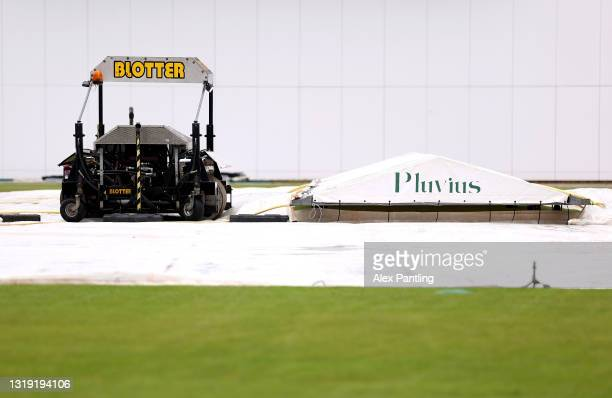Covers are pictured over the crease due to poor weather prior to the LV= Insurance County Championship match between Derbyshire and Durham at The...