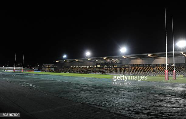 Covers are placed on the pitch at Rodney Parade in preparation for the FA Cup match during the European Rugby Challenge Cup match between Newport...
