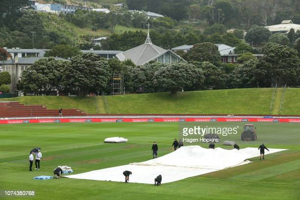 Covers are placed on the wicket during a rain delay on day five of the First Test match in the series between New Zealand and Sri Lanka at Basin...