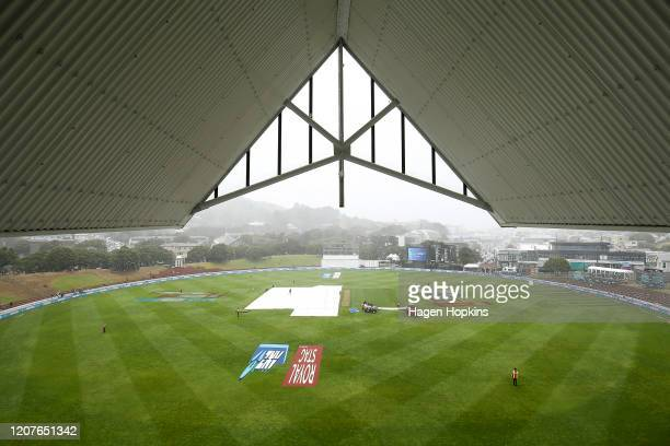 Covers are placed on the wicket during a rain delay on day one of the First Test match between New Zealand and India at Basin Reserve on February 21...