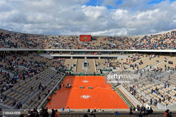 Covers are pulled over Court Philippe Chatrier due to a rain delay on Day thirteen of the 2019 French Open at Roland Garros on June 07, 2019 in...