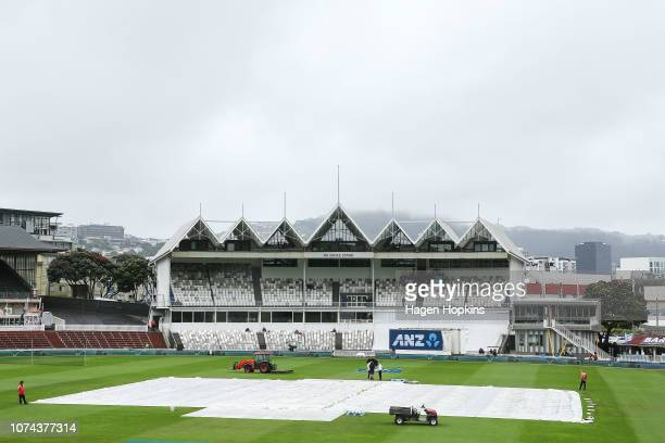 Covers lie on the wicket during a rain delay on day five of the First Test match in the series between New Zealand and Sri Lanka at Basin Reserve on...