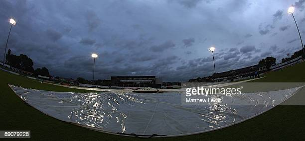 Covers out as play is delayed due to rain during the NatWest Pro40 Division Two match between Derbyshire and Northamptonshire at the County Ground on...
