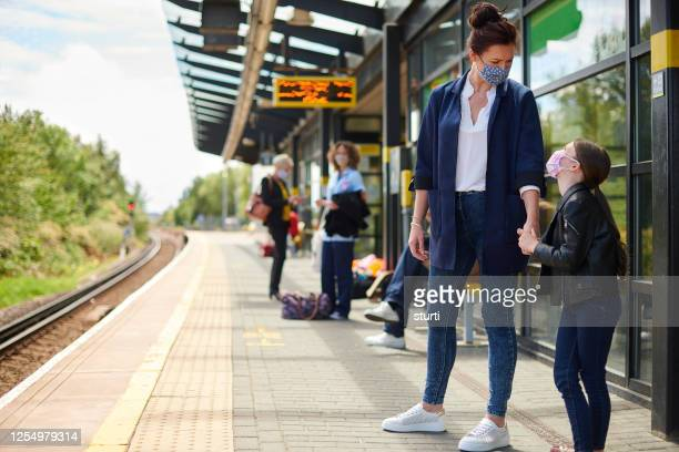covid era train travel - essential services stock pictures, royalty-free photos & images