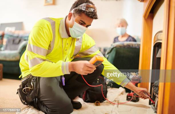 covid safe heating engineer - visit stock pictures, royalty-free photos & images