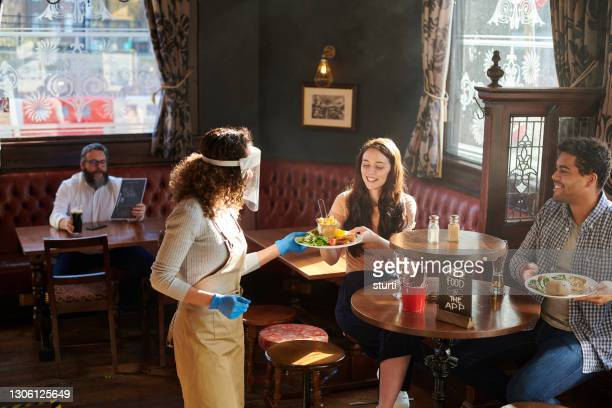 covid safe pub lunch - pub stock pictures, royalty-free photos & images