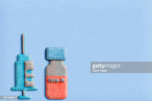 covid vaccine and syringe in felt with copyspace - diphtheria stock pictures, royalty-free photos & images