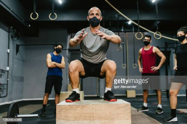 covid19: athletes during training at the gym - opening event stock pictures, royalty-free photos & images