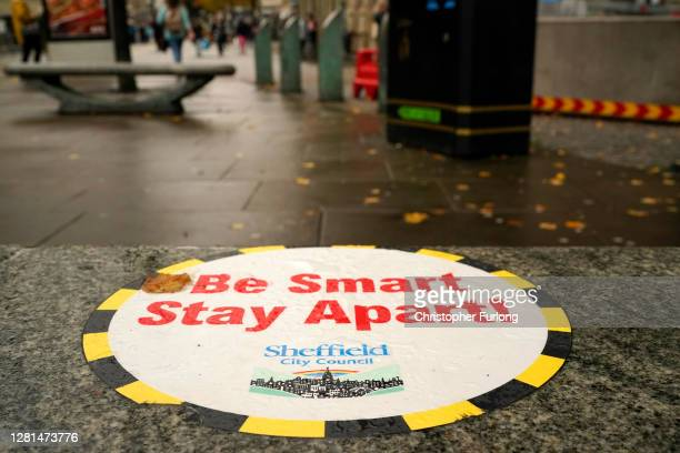 Covid-19 awareness sign greets shoppers in the city centre on October 22, 2020 in Sheffield, England. The county of South Yorkshire, which includes...