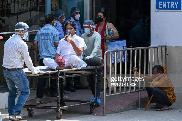 Covid-19 coronavirus patient is shifted to ward after admission at GTB hospital in New Delhi on April 29, 2021.
