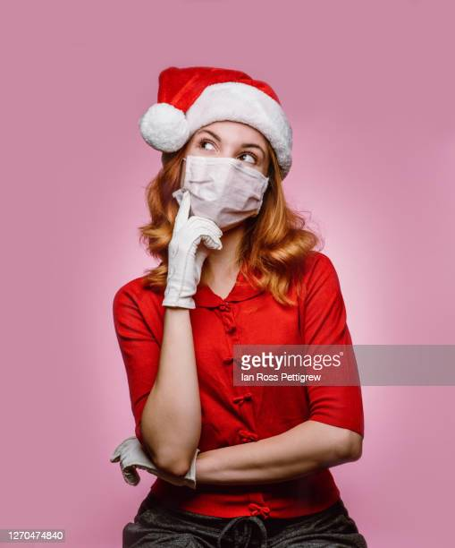 covid-19 female santa's elf - illness prevention stock pictures, royalty-free photos & images
