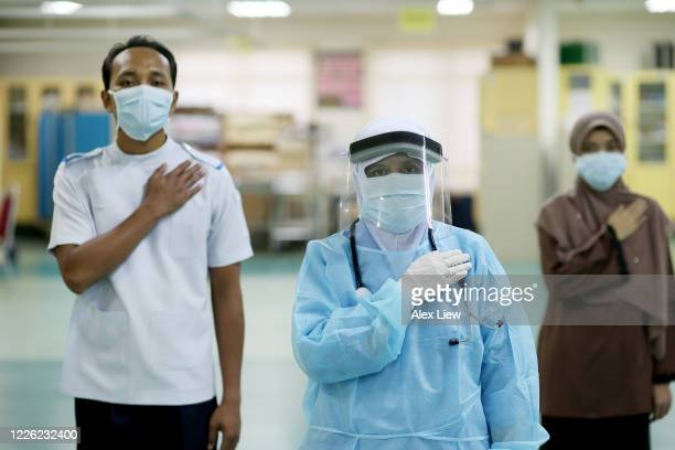covid-19: frontliners in malaysia hospital - frontline worker stock pictures, royalty-free photos & images