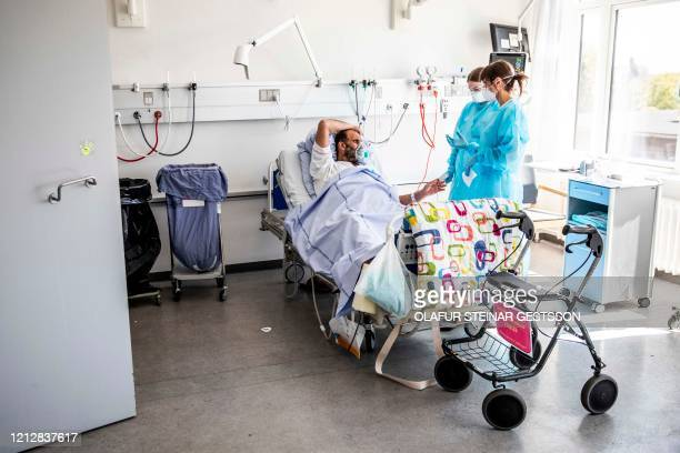 Covid-19 infected patient talks with medical staff at the lung medical unit at Bispebjerg Hospital in Copenhagen Denmark on May 7, 2020 amid the new...