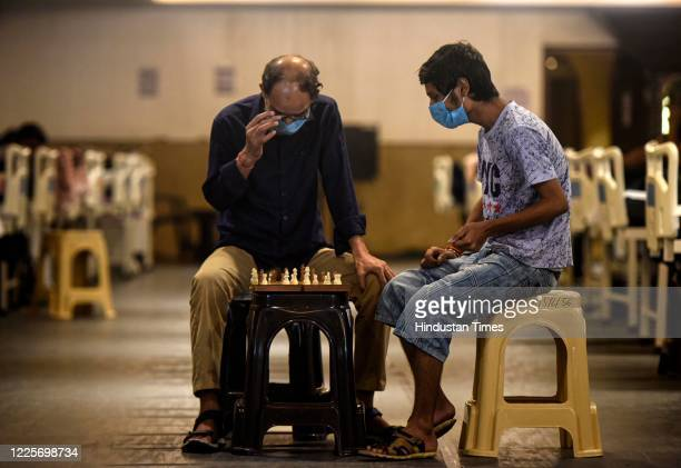 Covid-19 infected patients seen playing chess inside the Shehnai Banquet Hall quarantine centre attached to LNJP Hospital on July 8, 2020 in New...
