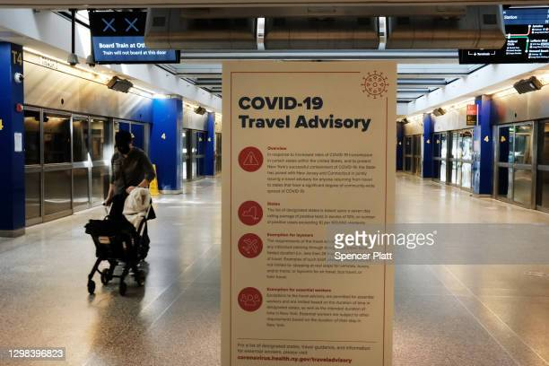Covid-19 information is displayed at an international terminal at John F. Kennedy Airport on January 25, 2021 in New York City. In an effort to...