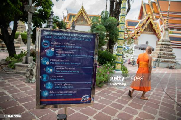 A Covid19 information sign stands at a nearempty Wat Pho in Bangkok Thailand on Wednesday Sept 2 2020 Thailand has reported zero locallytransmitted...