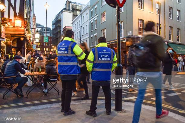 Covid-19 marshals on patrol in Old Compton Street, Soho. Crowds of people packed the bars and restaurants in Central London on the first Friday since...