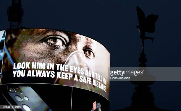 Covid-19 messaging is seen on the advertising hoarding at Piccadilly Circus during the UK's third national lockdown on February 03, 2021 in London,...