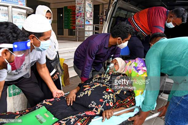 Covid-19 patient is being taken to Dhaka Medical College Hospital with her family members for treatment in Dhaka. Bangladesh extends nationwide...