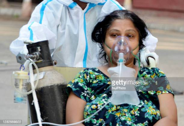 Covid-19 patient on a wheel chair goes for a medical test inside a government hospital in Kolkata, India, 27 April, 2021. The World Health...