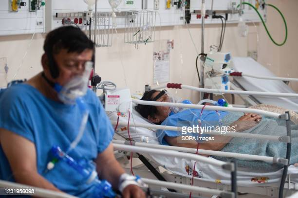 Covid-19 patients seen wearing a respiratory mask on hospital beds at IESS Quito Sur hospital. In recent weeks the Ecuadorian capital has observed a...