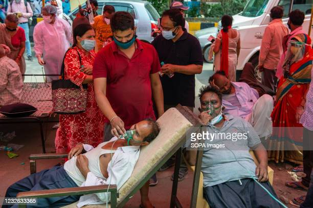 Covid-19 patients wearing oxygen masks receives free oxygen at Gurudwara. India faces shortage of medical oxygen. In this situation NGO Khalsa Help...