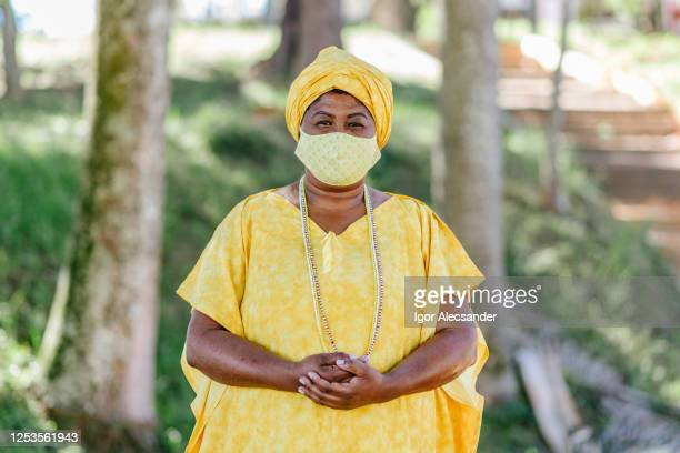 covid-19: portrait of a brazilian religious woman in the public park - africa stock pictures, royalty-free photos & images