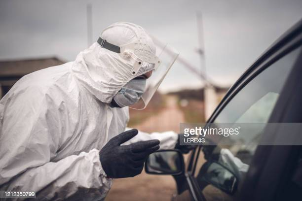 covid19 -  quarantine - face mask protective workwear stock pictures, royalty-free photos & images
