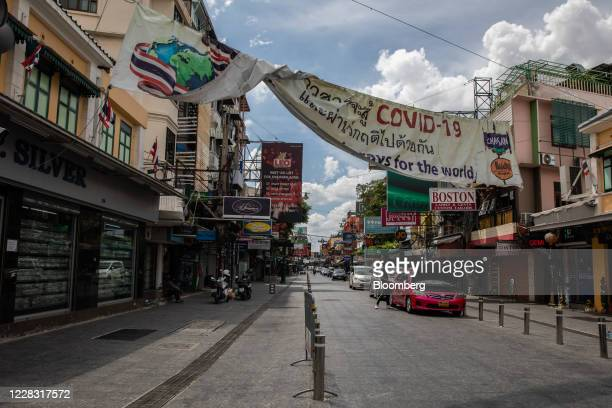 A Covid19 sign hangs at an entrance to a nearempty Khao San Road in Bangkok Thailand on Wednesday Sept 2 2020 Thailand has reported zero...