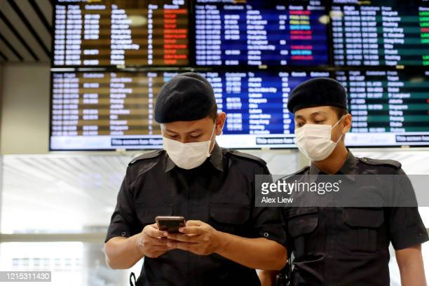 covid-19: south east asia - at the airport - epidemic stock pictures, royalty-free photos & images