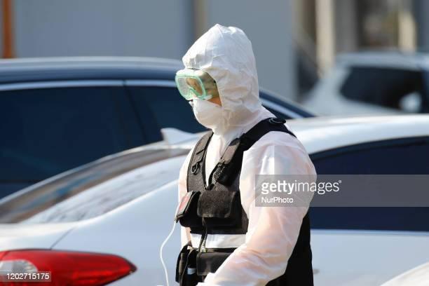 Covid19 suspect transport fire fighter ambulance staff walk back ambulance at medical center in Daegu, South Korea, on February 23, 2020. South...